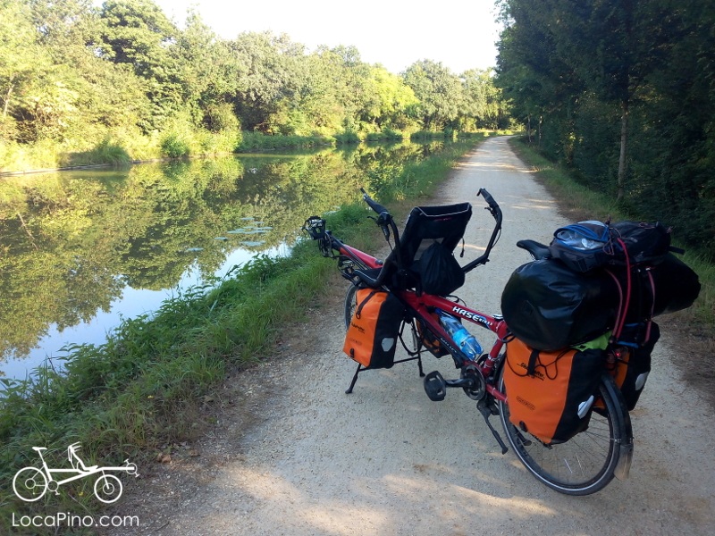 A semi recumbent Hase tandem Pino and its panniers on the canal between Nantes and Brest / Roscoff near Nort sur Erdre in France