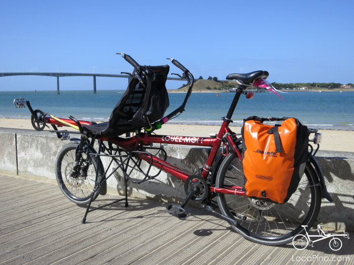 A Pino tandem bike on the beach near Fromentine in France and in front of the bridge which leads to the Normoutier island